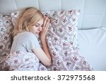 woman sleeping lying on the bed ... | Shutterstock . vector #372975568