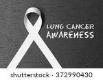 white ribbon. lung cancer... | Shutterstock . vector #372990430