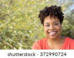 happy african american woman | Shutterstock . vector #372990724