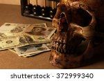 skull on old wood with banknote ... | Shutterstock . vector #372999340