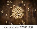raw cashew nuts in bowl on... | Shutterstock . vector #373001254