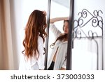 young woman looking herself... | Shutterstock . vector #373003033