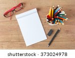 top view of open notebook and... | Shutterstock . vector #373024978