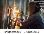 worker and metal cutting with... | Shutterstock . vector #373068019