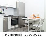 Interior Of Small White Kitche...