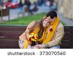 Love Couple Sitting On A Bench...