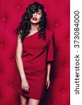 Small photo of Hair, hairstyle, healthcare, make up. Beautiful woman in claret dress with long curly hair