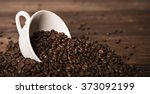 a cup filled with coffee beans | Shutterstock . vector #373092199