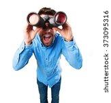 Young Man Using Binoculars