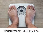 weighing on analog weight scale | Shutterstock . vector #373117123