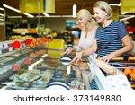 smiling women buying frozen... | Shutterstock . vector #373149880