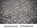 old cobbles after rain. toned... | Shutterstock . vector #373186444