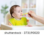 happy kid girl eating food with ... | Shutterstock . vector #373190020