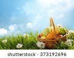Basket Of Easter Eggs On Green...