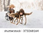 two boys sledding with mountain ... | Shutterstock . vector #373268164