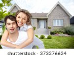 happy couple near new house. | Shutterstock . vector #373276624