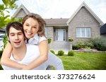 happy couple near new house. | Shutterstock . vector #373276624