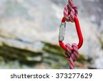 Carabiner With Rope On Rocky...