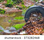 trash in the forest. old tire | Shutterstock . vector #373282468