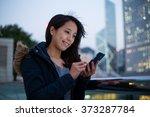 asian girl using mobile phone... | Shutterstock . vector #373287784