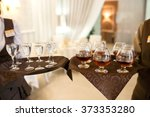 waiter with a tray welcomes... | Shutterstock . vector #373353280
