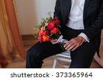 groom with bouquet   Shutterstock . vector #373365964