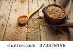 lentils and wooden spoon on a... | Shutterstock . vector #373378198