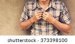 vintage man wearing a plaid... | Shutterstock . vector #373398100