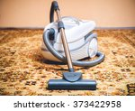 vacuum cleaner on a persian rug.... | Shutterstock . vector #373422958