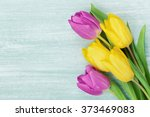 Tulip Flowers On Rustic Table...
