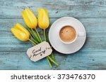 coffee mug with yellow tulip... | Shutterstock . vector #373476370