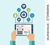 the tablet in hands of doctor.... | Shutterstock .eps vector #373486846