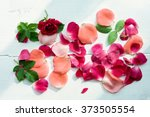 Stock photo rose petals leaves on white wooden background top view natural flower background romantic floral 373505554