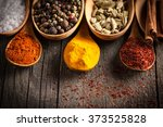 spices. spice in wooden spoon.... | Shutterstock . vector #373525828