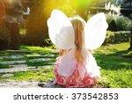 Little Girl In A Garden