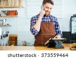 handsome smiling barista with... | Shutterstock . vector #373559464