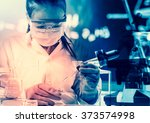 scientist with equipment and... | Shutterstock . vector #373574998