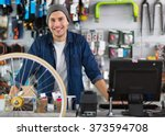 salesman in bicycle shop  | Shutterstock . vector #373594708