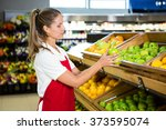 Female Worker Taking Fruits In...