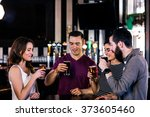 friends having a pint in a bar | Shutterstock . vector #373605460