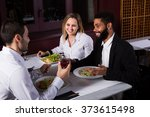 three smiling friends eating at ... | Shutterstock . vector #373615498