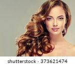 beautiful girl with long wavy... | Shutterstock . vector #373621474