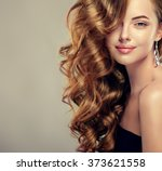 beautiful girl with long wavy... | Shutterstock . vector #373621558