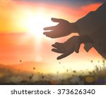 Small photo of Close up Jesus Christ hands open palm up on blurred sunset background. Mercy Humble Reconcile Adoration Glorify Christmas Blessed God Help Christian Muslim Ramadan Kareem Sun Son Need Soul concept