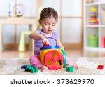 Toddler Girl Playing Indoors...