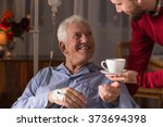 male carer assisting incurable... | Shutterstock . vector #373694398