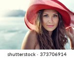 beautiful girl in a red hat... | Shutterstock . vector #373706914