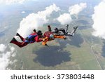 group of skydivers in freefall. | Shutterstock . vector #373803448