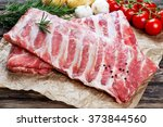 raw ribs with a rosemary and... | Shutterstock . vector #373844560