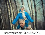 Grandfather Carries Grandson O...